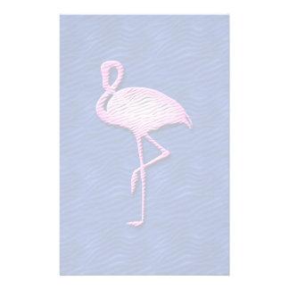 Pink flamingo on blue stationery