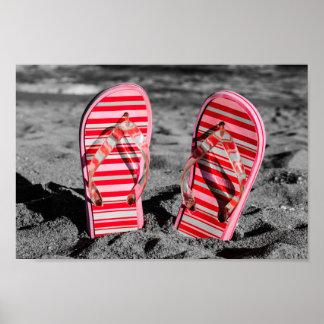 Pink flip flops on the beach. póster