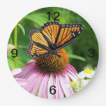 pink flower and monarch butterfly wall clock