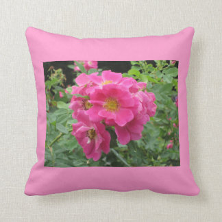 Pink Flower Pillow with Lush Green Background