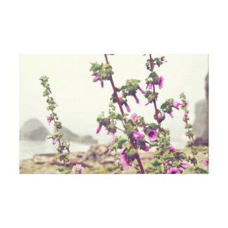 Pink Flowers Against an Ocean Backdrop Canvas Print