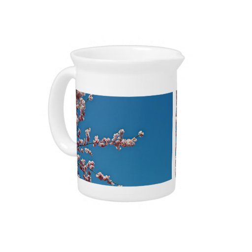 Pink Flowers Against Blue Sky Beverage Pitcher