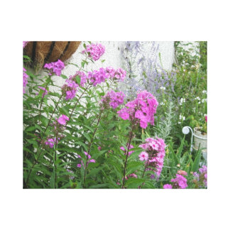Pink Flowers In The Garden Stretched Canvas Print