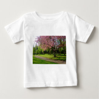 Pink flowers Of prunus in a park Baby T-Shirt