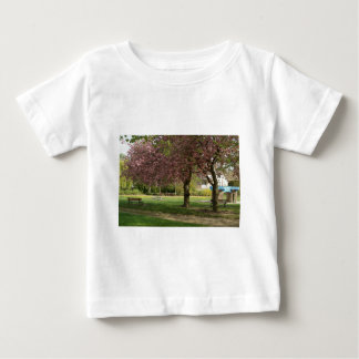 Pink flowers of Prunus protect a children castle Baby T-Shirt
