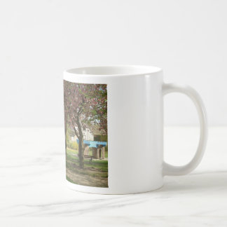 Pink flowers of Prunus protect a children castle Classic White Coffee Mug