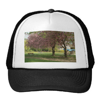 Pink flowers of Prunus protect a children castle Trucker Hat