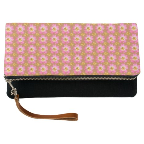 Pink flowers with golden dots on brown clutch