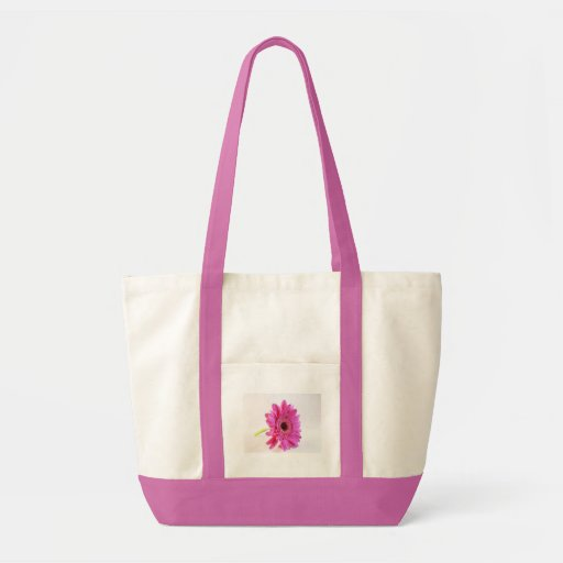 pink gerber on white bags