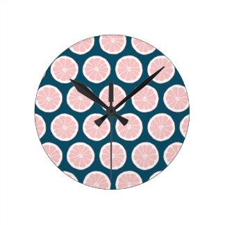 Pink Grapefruit on Blue Background Graphic Pattern Round Clock