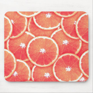 Pink grapefruit slices mouse pad