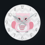 """Pink Grey Owl Wall Clock<br><div class=""""desc"""">This adorable pink and grey owl on grey and white chevron background design will look perfect in your little one&#39;s nursery or bedroom. Perfect for newborns,  babies,  toddlers or child&#39;s bedroom. Other matching products available in my store!</div>"""