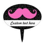 Pink handlebar mustache on black damask pattern oval cake pick
