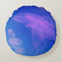 Pink jellyfishes in blue water round pillow