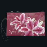 """Pink Lillies Suede Wristlet<br><div class=""""desc"""">A ruby background color with painted stargazer lillies in shades of pink,  red,  and white.  Add your name to the text field or clear it out if wish.  You can also click on &quot;Customize It!&quot; to adjust the font type,  size,  color,  placement,  etc.  Artwork and design by Karlajkitty.</div>"""