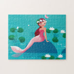 "Pink Mermaid Puzzle<br><div class=""desc"">A sweet little Mermaid sitting on a stone surrounded by water lilies. A cute design with beautiful illustrations by Ulla at mermaid.fi (that's me!). Perfect for all little girls or also bigger ones as a birthday gift, or for anyone who loves the summer and sea and life on the beach....</div>"