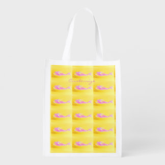 pink mermaids swimming on yellow reusable grocery bag
