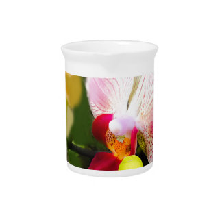 Pink orchid with tennis ball drink pitcher