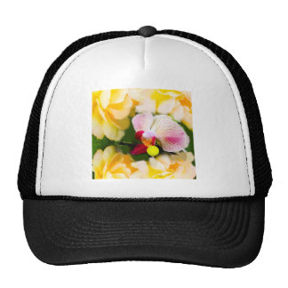 Pink orchid with tennis ball trucker hat