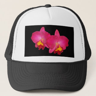 Pink orchids, black trucker cap