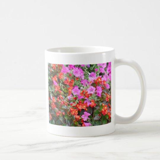 Pink petunia and red geraniums coffee mug