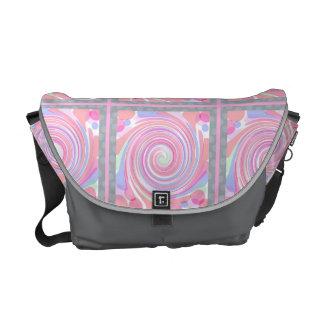 Pink pinwheel abstract pattern messenger bag