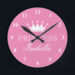 "Pink princess crown wall clock for girls bedroom<br><div class=""desc"">Pink princess crown wall clock for girls bedroom or baby nursery. Cute baby shower or birthday gift idea. Custom home decor with personalizable name of child. Girly room decoration for children. Round wallclock. Elegant script typography for name or monogram.</div>"