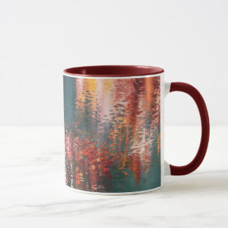 Pink red and yellow reflections on blue green mug