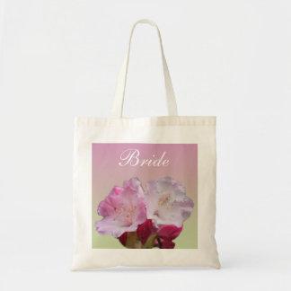 pink rhododendron flowers  bride/groom bag
