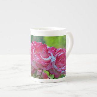 Pink rose blossoms tea cup