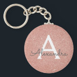 "Pink Rose Gold Glitter &amp; Sparkle Monogram Keychain<br><div class=""desc"">Pink Rose Gold Faux Glitter and Sparkle Elegant Keychain. These Keychains can be customized to include your initial and first name and are a perfect bridal shower,  bachelorette party or birthday party favor.</div>"
