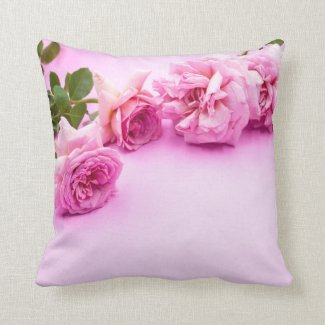 Pink roses are on pink background throw pillow