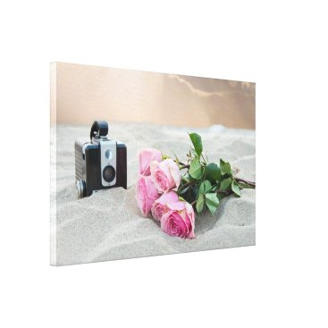 Beach Themed pink roses in sand with retro camera canvas print