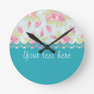 Pink roses with ligth blue crowns reloj de pared