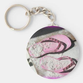 Pink sandy flip flop sandals on Florida beach Basic Round Button Keychain