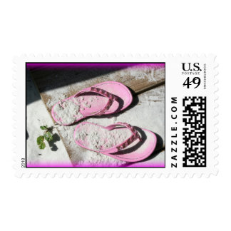Pink sandy flip flop sandals on Florida beach Stamp
