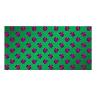 Pink shamrocks on green background photo cards