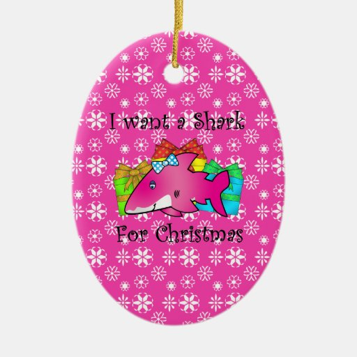 Pink shark on presents and pink snowflakes Double-Sided oval ceramic christmas ornament