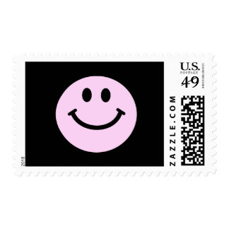 Pink smiley face postage stamp