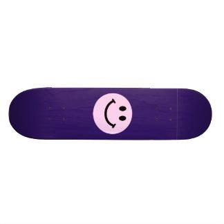 Pink smiley face skateboard deck