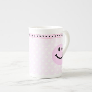 Pink smiley face tea cup