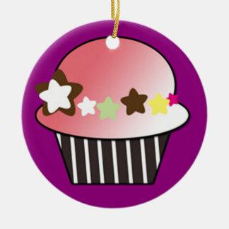 pink star cupcake on purple background ornament