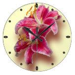 Pink Stargazer Lilies Round Clocks