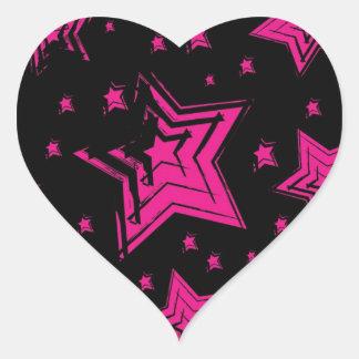 Pink stars on black background.jpg heart sticker