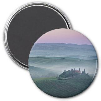 Pink sunrise over a Tuscany landscape round magnet