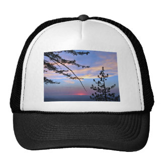 Pink sunset with pine trees and clouds trucker hat