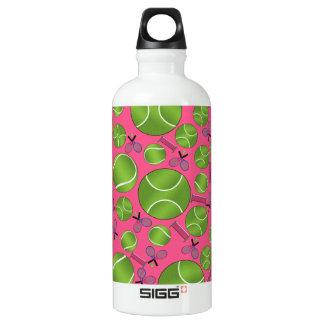 Pink tennis balls rackets and nets water bottle
