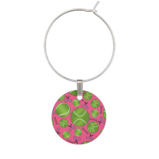 Pink tennis balls rackets and nets wine glass charms