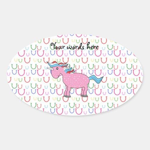 Pink unicorn on horseshoes oval sticker