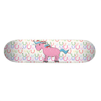 Pink unicorn with white stars skateboard deck